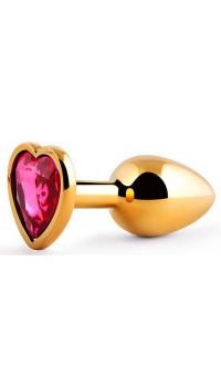 Золотистая анальная пробка с малиновым кристаллом-сердечком - 7 см.